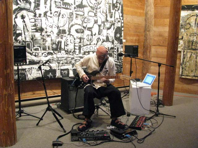 Lez-Playing-Guitar-at-the-Opening-of-his-Paintings-Exhibition