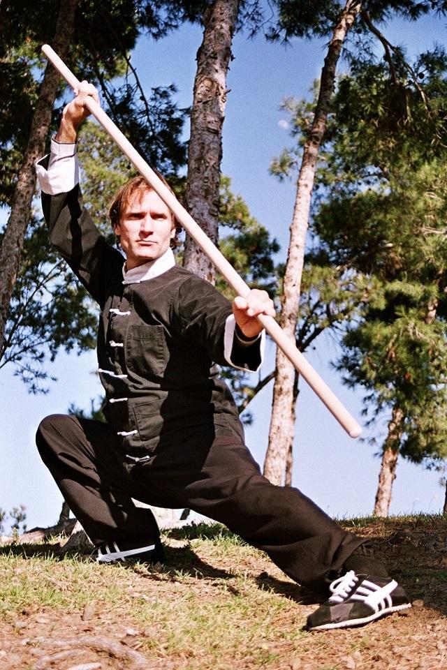 Master-Luis-Molera-doing-a-Taiji-Form-with-a-Stick